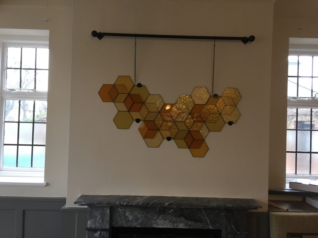 A free hanging copper foiled design for a pub