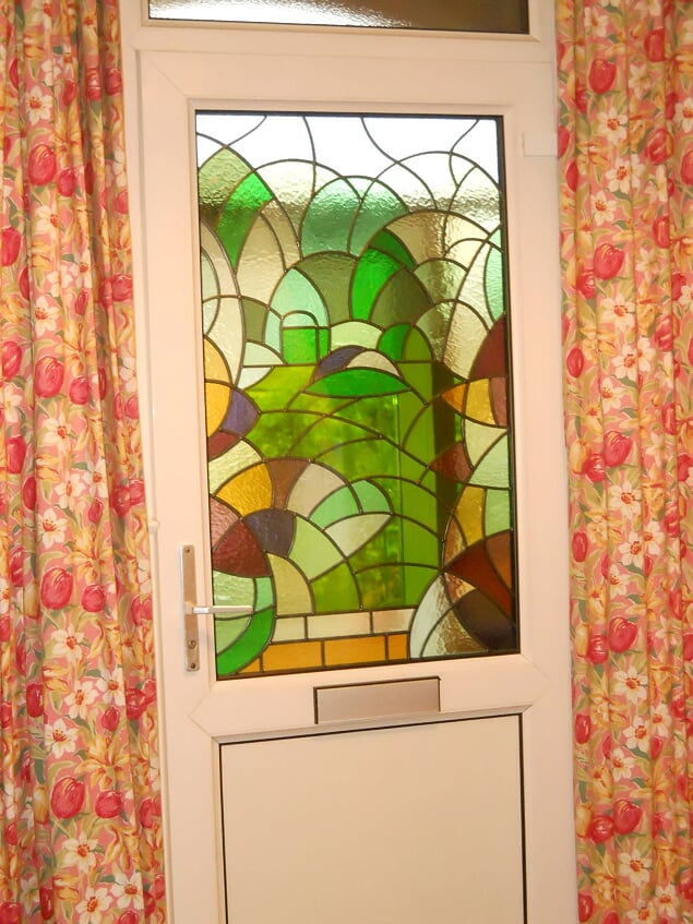A new design triple glazed leaded light swapped with an existing clear glazed panel.