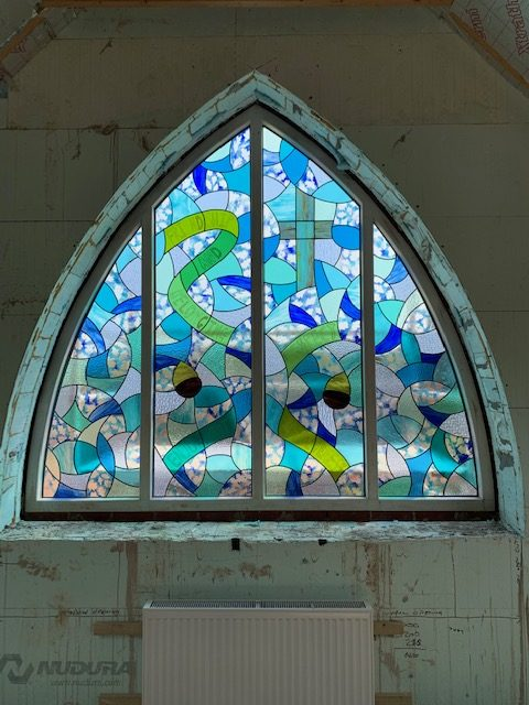 A stained glass panel for a new extension at Swannington primary school. The background glass was made by pupils at a my studio.