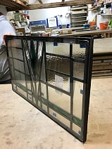 A matching leaded light, triple glazed
