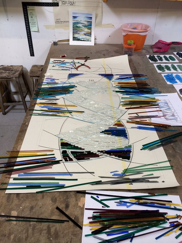 A fused glass and leaded landing window based on the customers painting