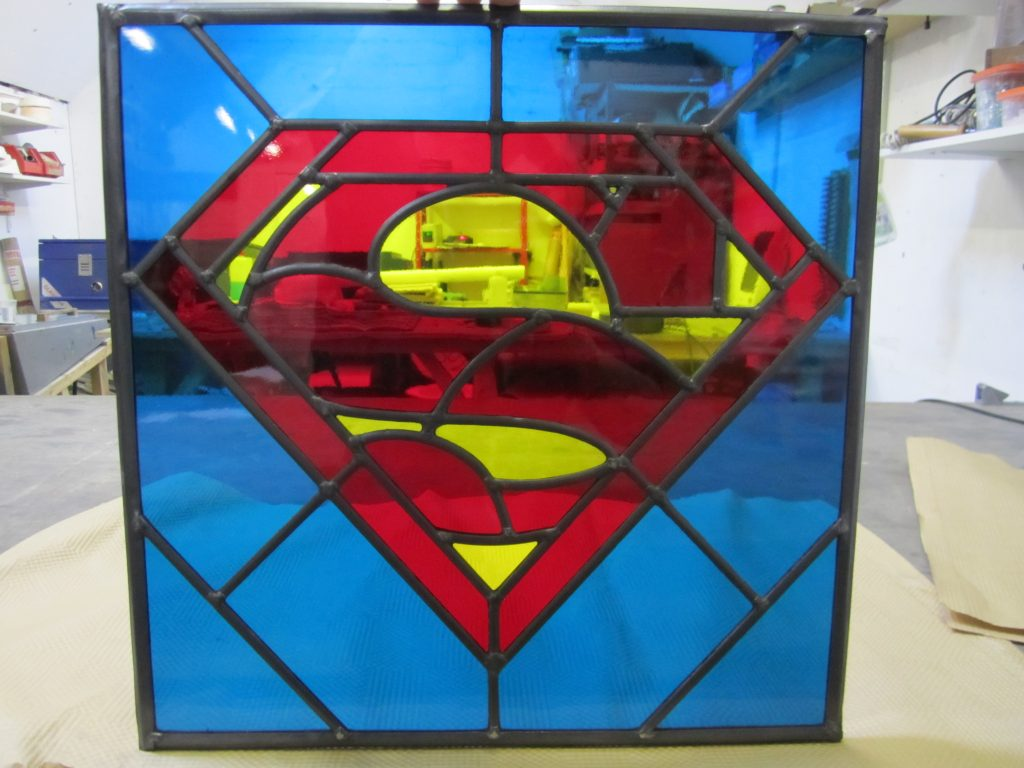 A funky little superman leaded light