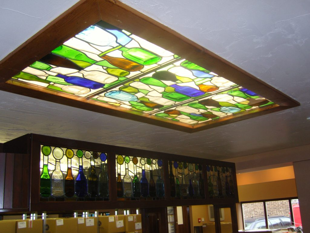 One of three ceiling panels using flattened bottles.
