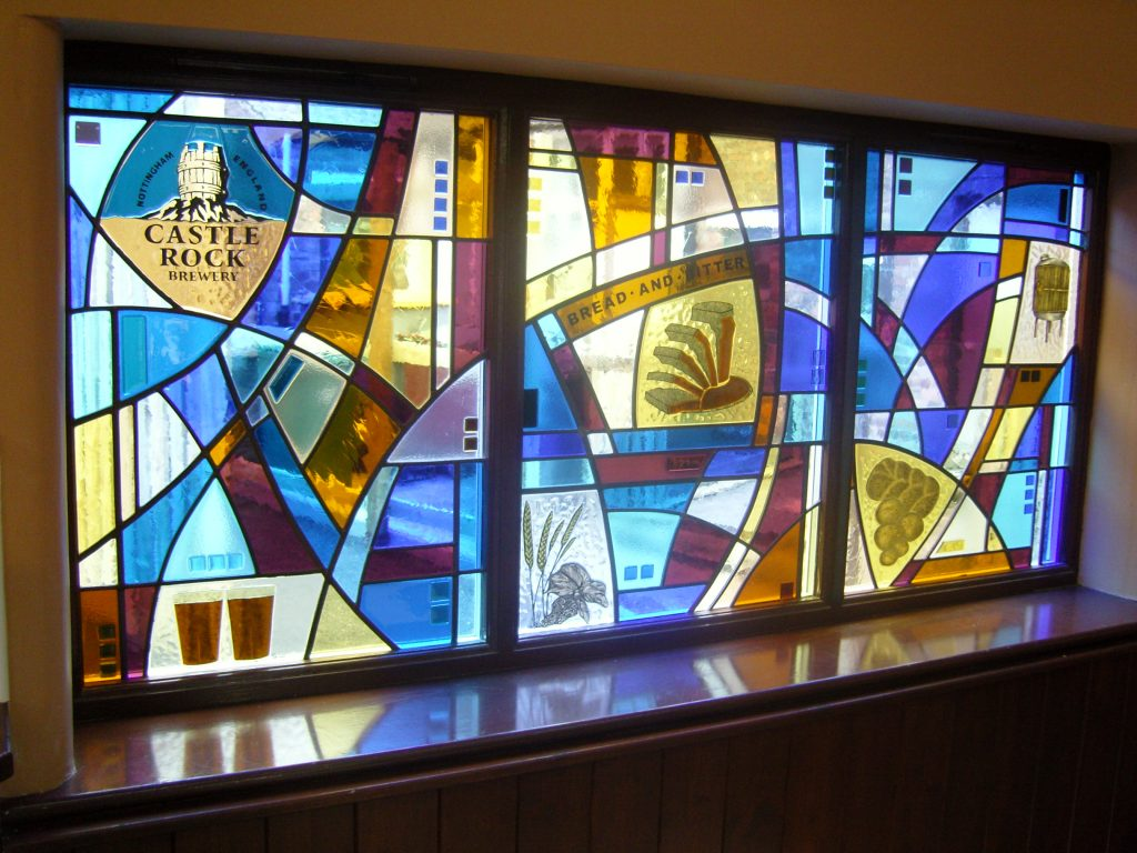 A set of fuse glass and handpainted windows for the Bread and bitter pub in Nottingham.