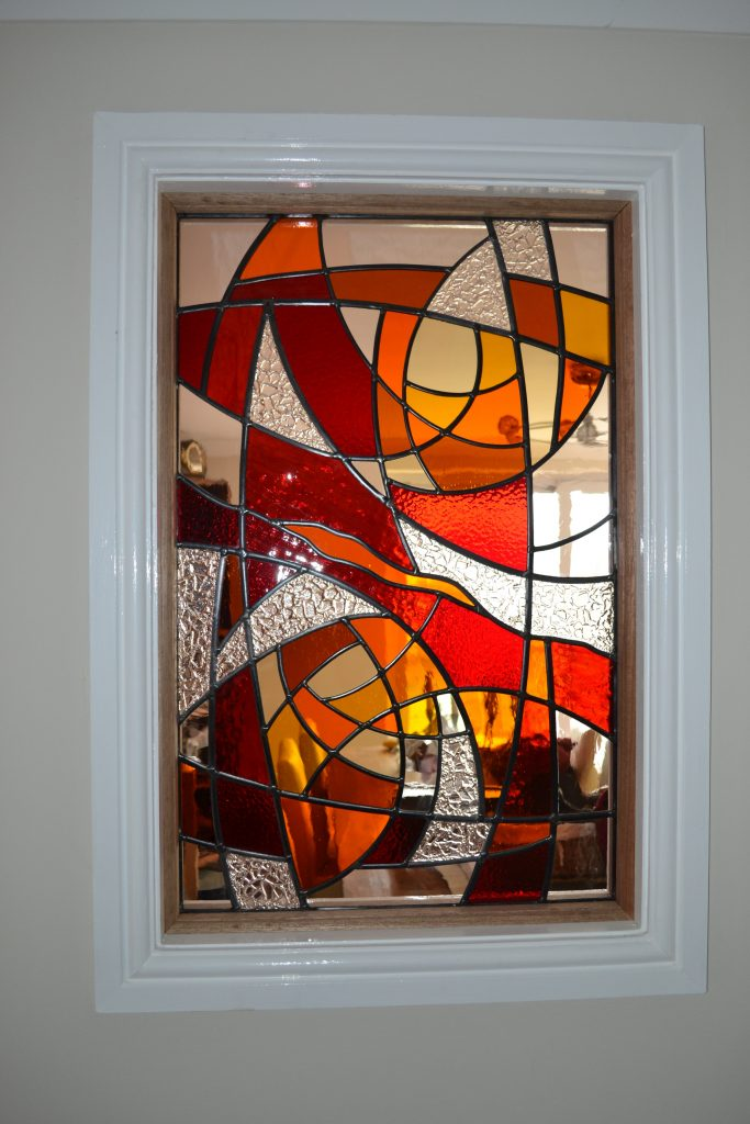 A contemporary panel inbetween a living room and hallway.