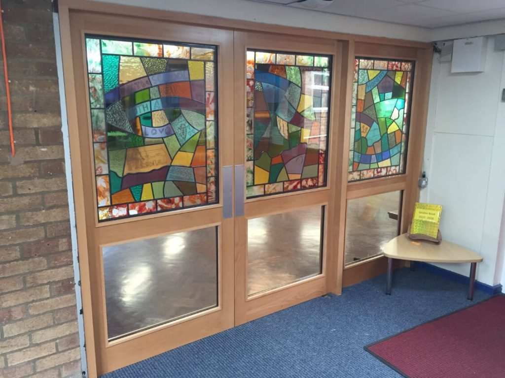 As set of three fused glass, decaled and leaded panel for Queniborough Primary School
